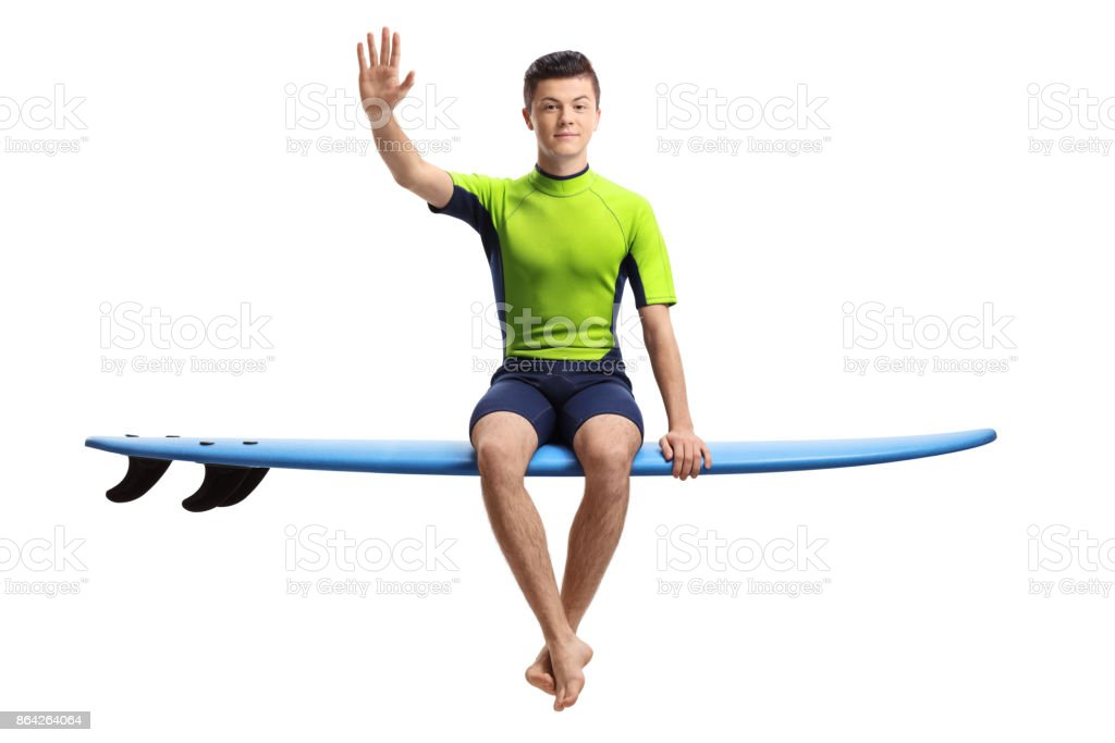 Teenage surfer waving at the camera royalty-free stock photo