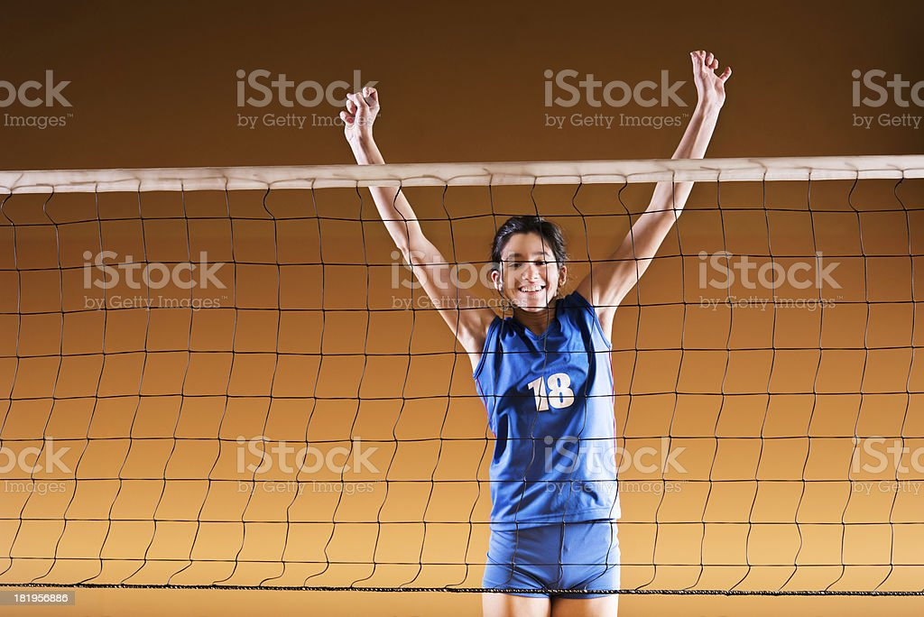 Teenage volleyball player on the net. royalty-free stock photo
