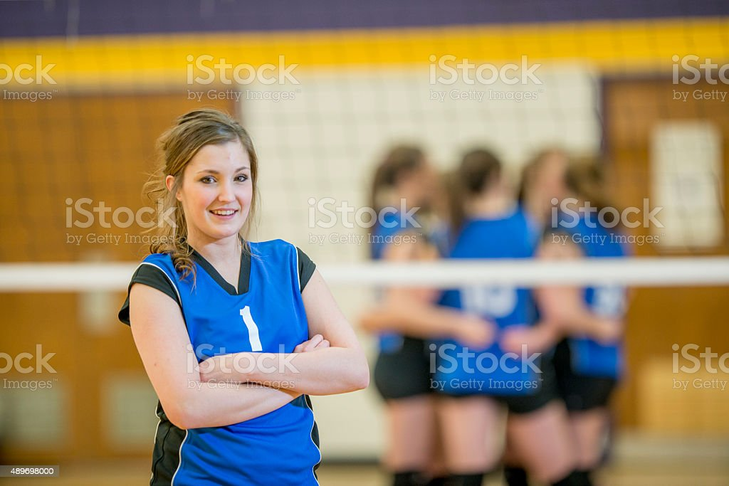 Teenage Volleyball Players in the Gym stock photo