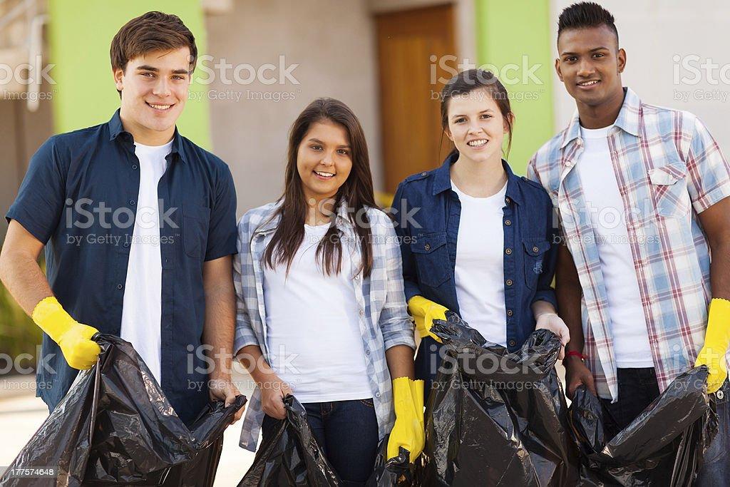 teenage volunteers with garbage bag stock photo