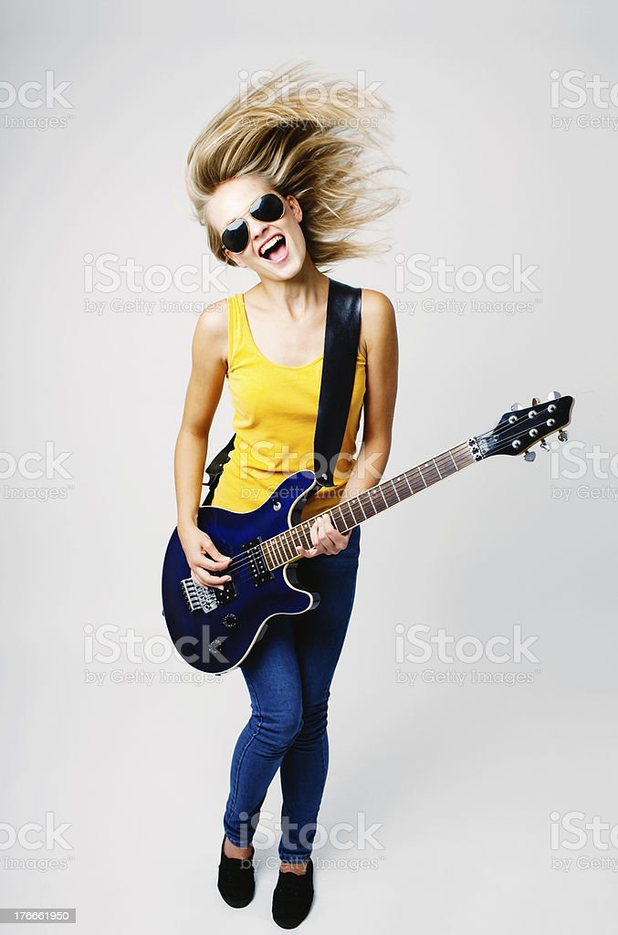 Teenage woman playing on guitar stock photo