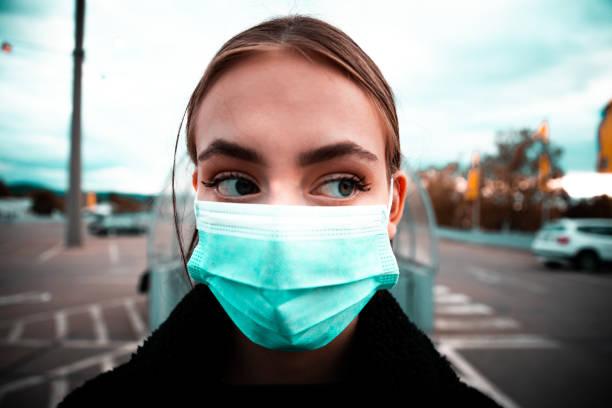 Teenage Woman with Face Mask Corona Covid-19 Portrait stock photo
