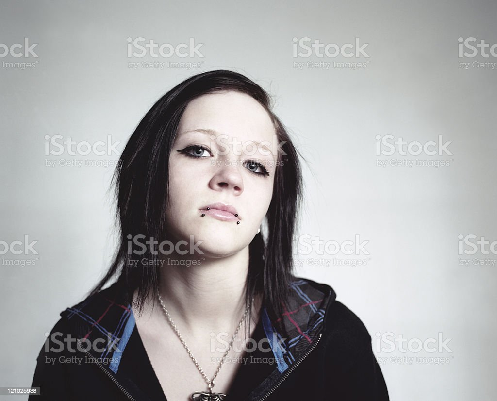 Teenaged girl with piercings stock photo