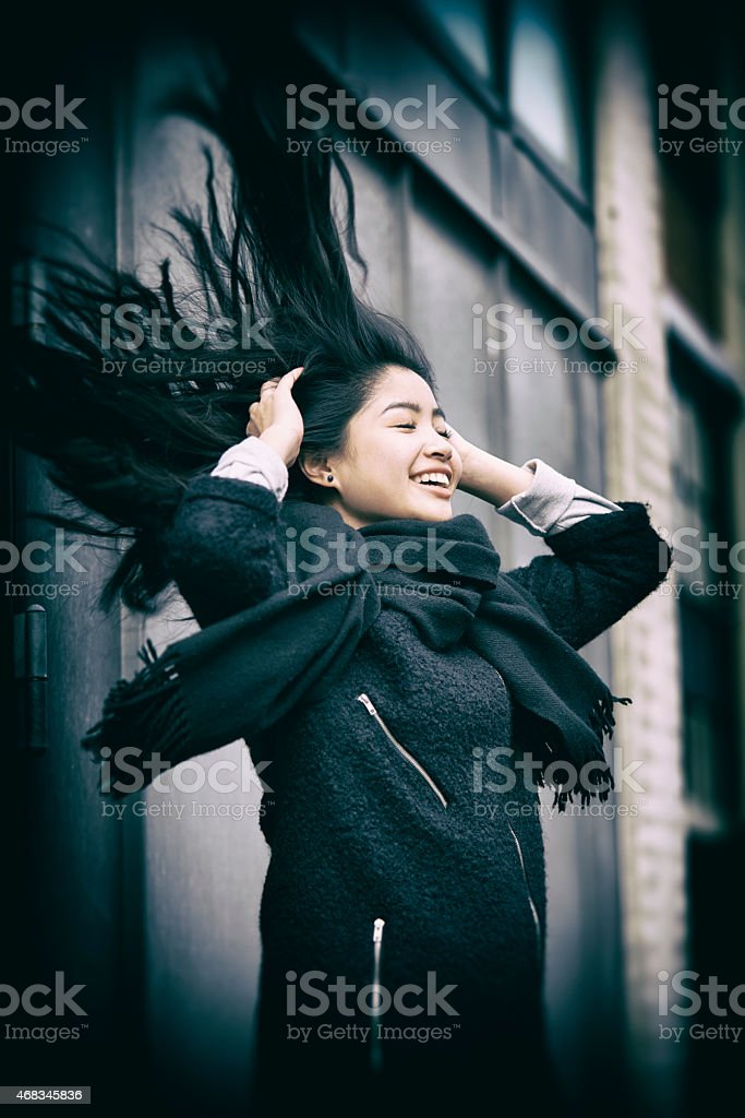 Teenager a windy day outdoor playing with the hair royalty-free stock photo
