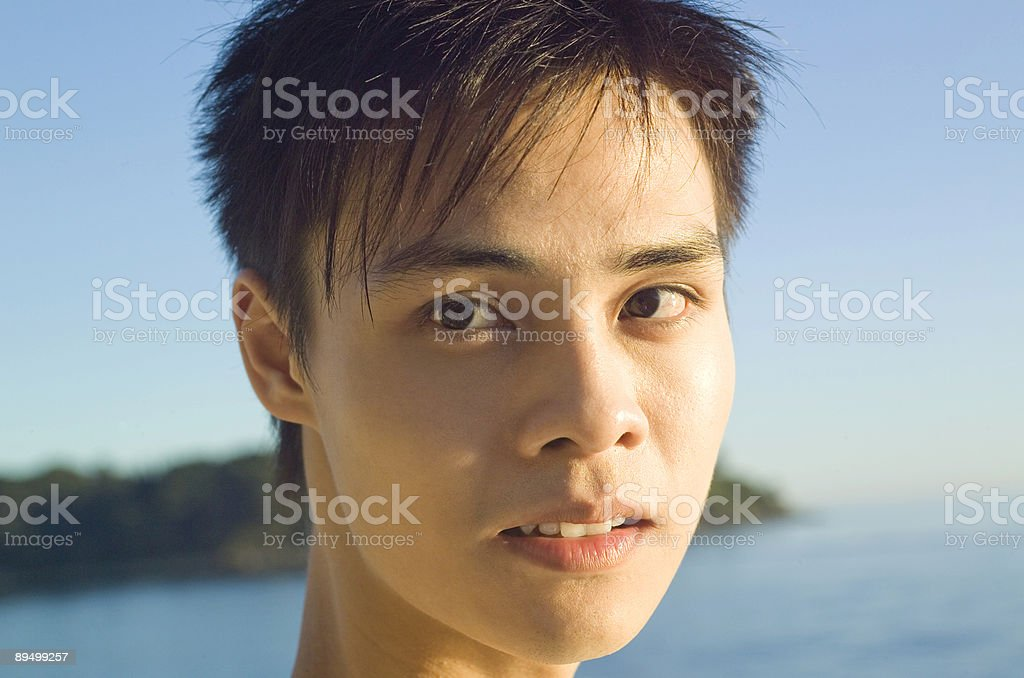 Teenager against ocean royalty free stockfoto