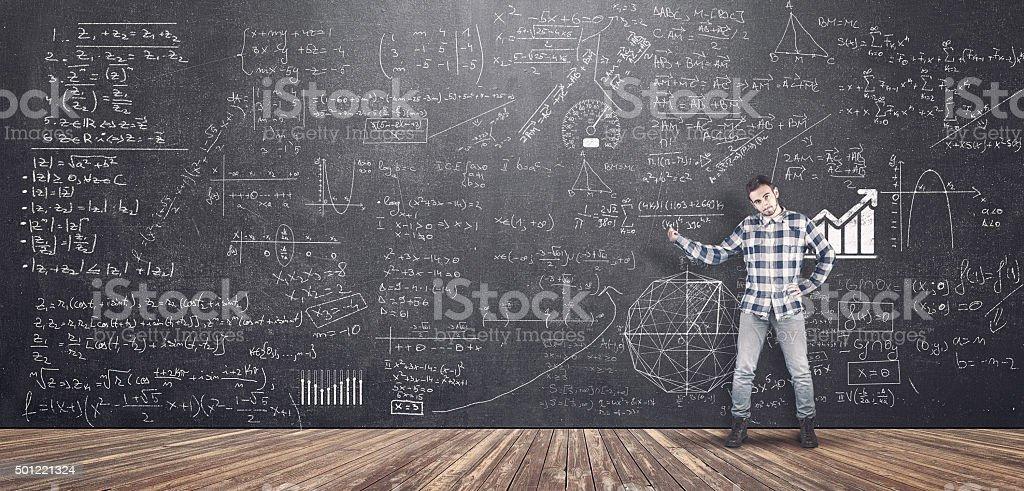 Teenager and blackboard stock photo