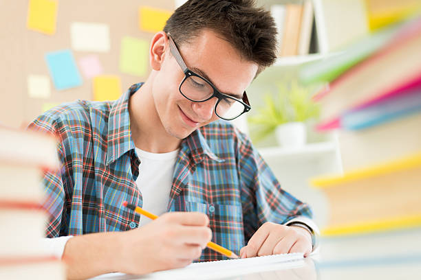 Teenager and books stock photo