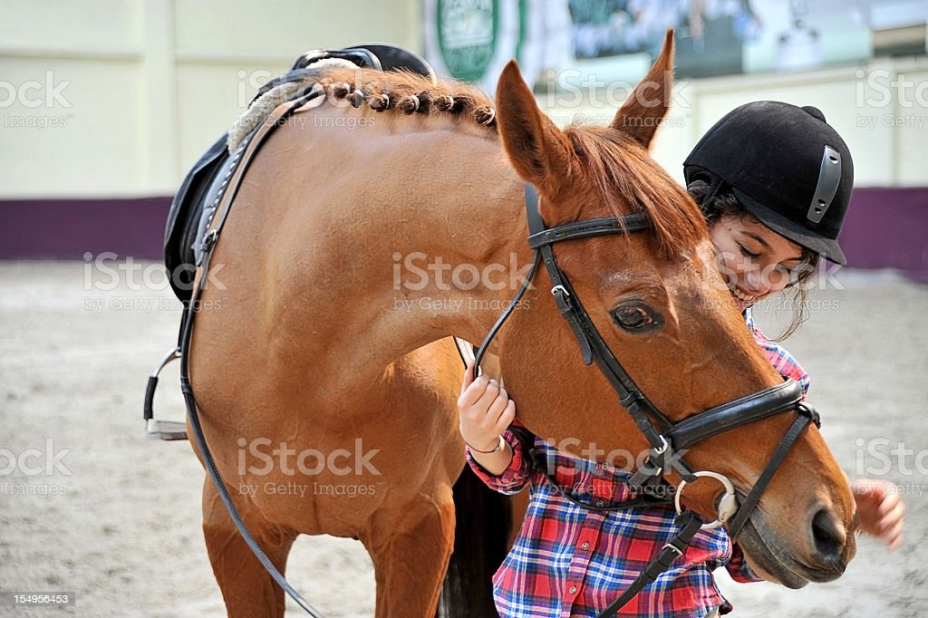 teenager and her horse royalty-free stock photo
