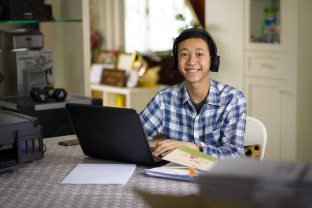 Teenager and online class at home stock photo