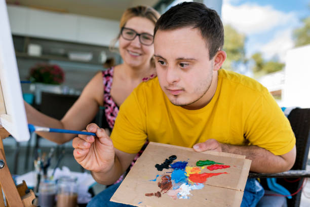 Teenager artist with Down syndrome stock photo