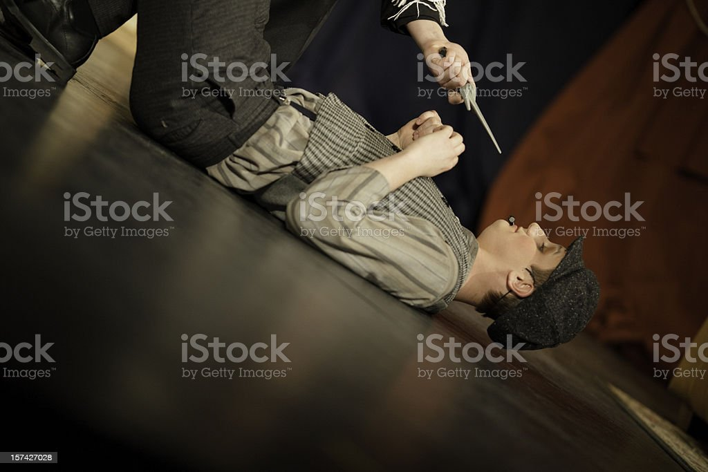 Teenager at knife point stock photo