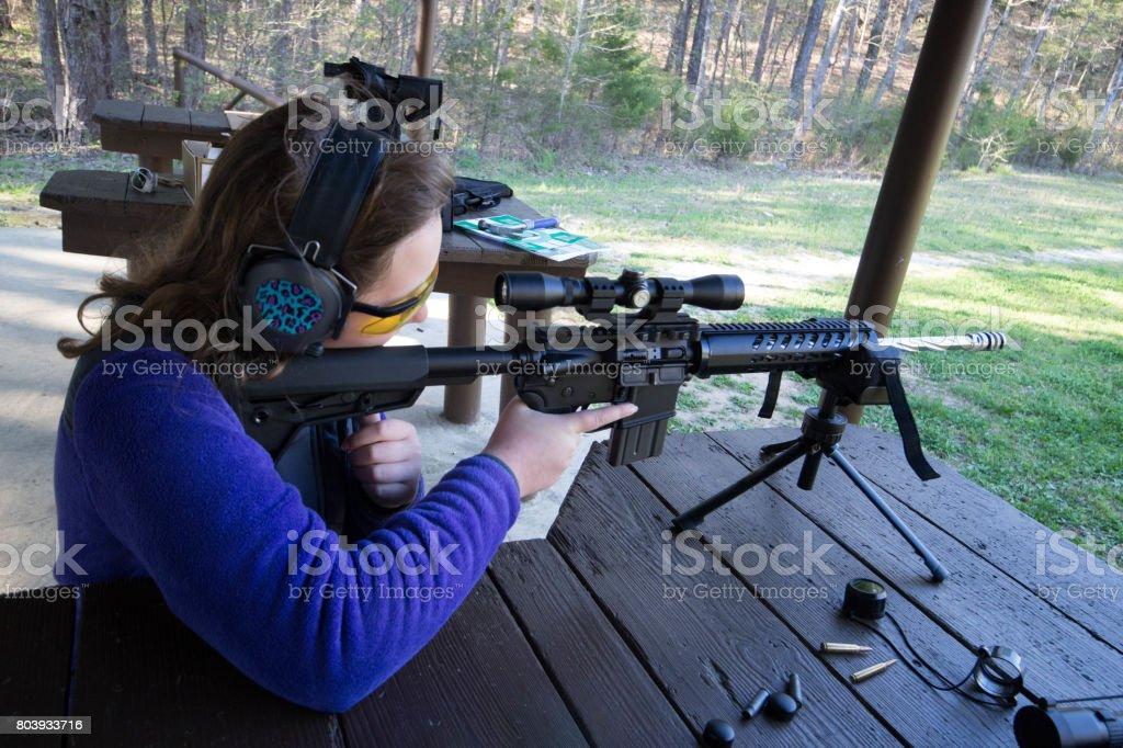 Teenager at shooting range stock photo