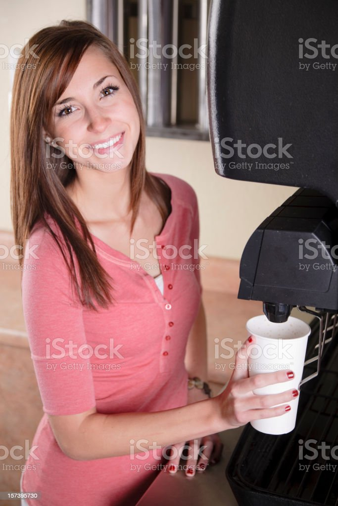 Teenager at Soda Fountain in Fast Food Restaurant stock photo