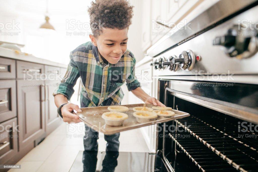 Teenager baking cookies stock photo