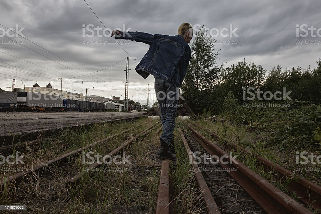 teenager balance on rairoad track royalty-free stock photo
