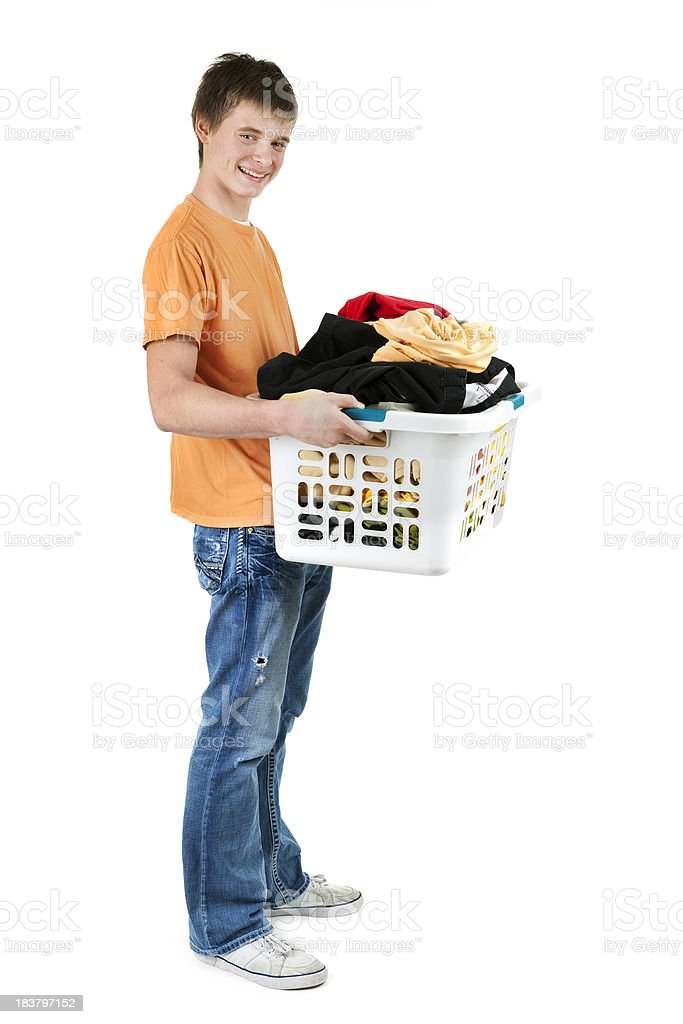 Teenager Boy Carrying Full Laundry Basket of Clothes on White royalty-free stock photo