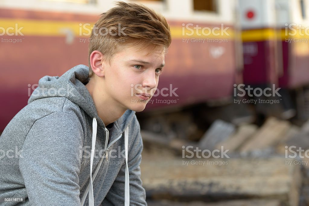 Teenager boy outdoors stock photo