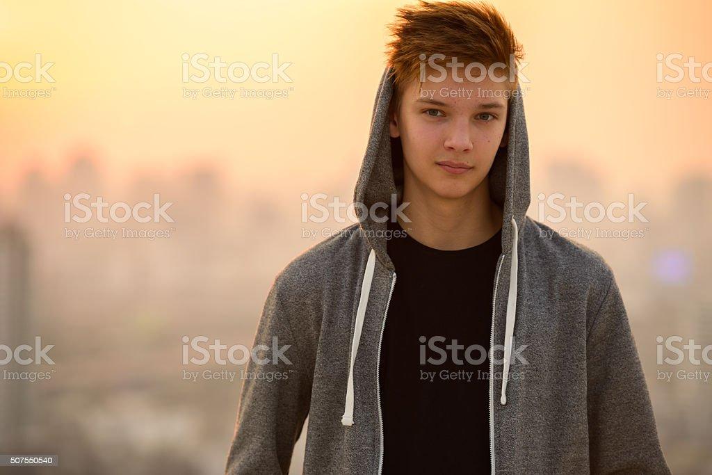 Teenager boy outdoors stock photo