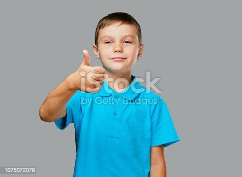 istock Teenager boy shows big finger up. 1075072076