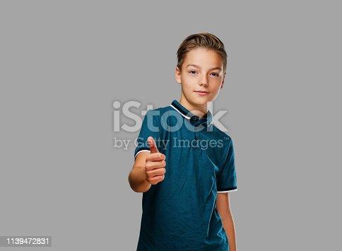 istock Teenager boy shows big finger up. 1139472831