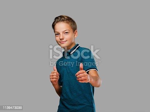 istock Teenager boy shows big finger up. 1139473035