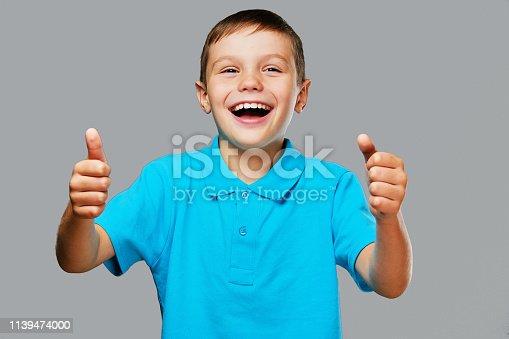 istock Teenager boy shows big finger up. 1139474000
