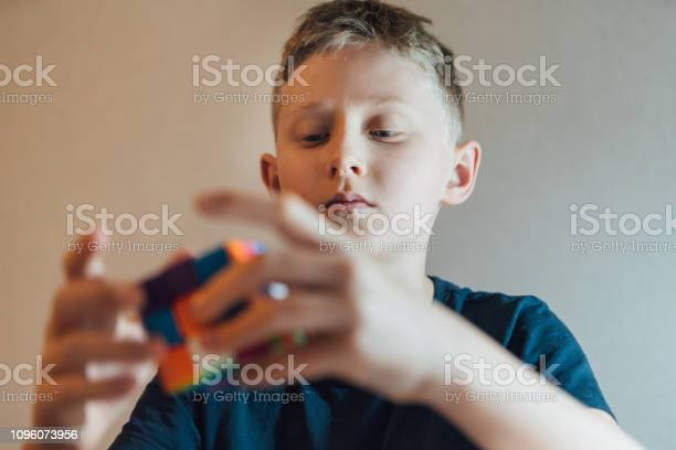 Teenager boy solving famous 3d combination puzzle toy in his kids picture id1096073956?b=1&k=6&m=1096073956&s=612x612&h=puiz0puh5ks01ooxfgjlwcg6y rj63wyf g zkn4yho=