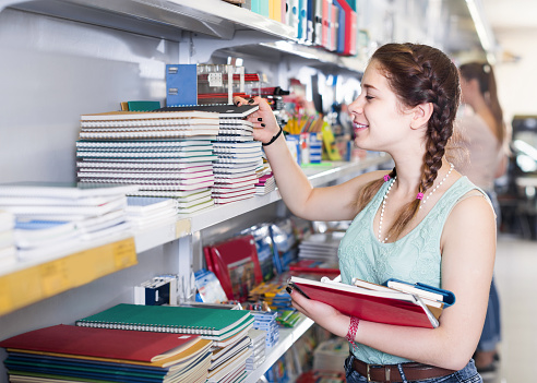 Teenager Buying Different Products In Stationery Shop Stock Photo - Download Image Now