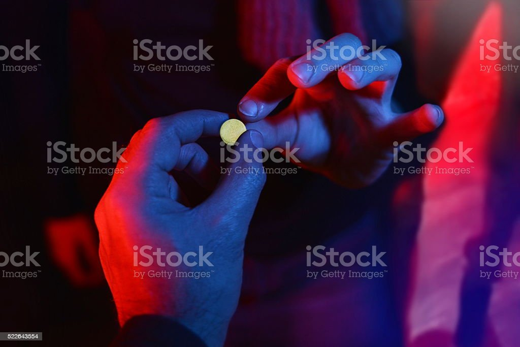 teenager buying drug at club stock photo