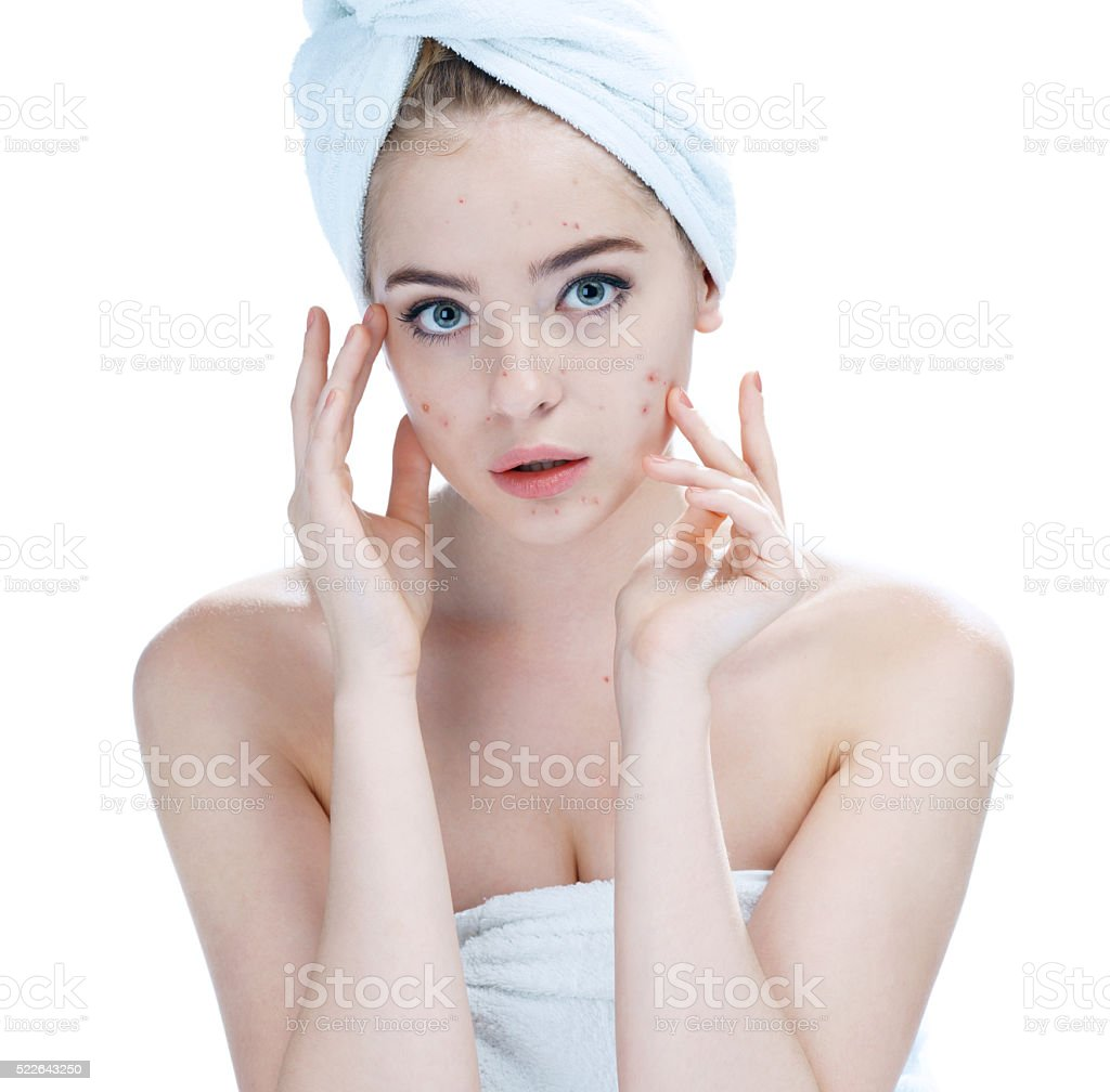 Teenager checking her face for pimple. stock photo