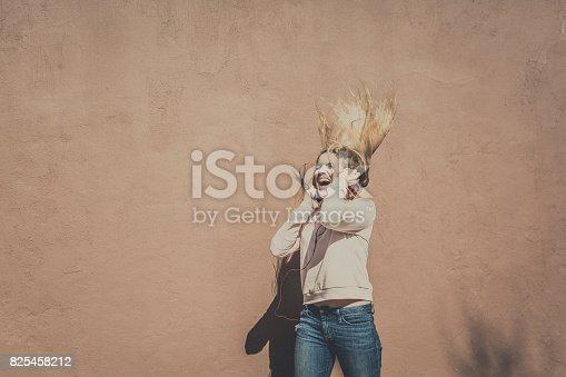 istock Teenager dancing to her music 825458212