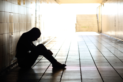 Teenager Depressed Sitting Inside A Dirty Tunnel Stock Photo - Download Image Now