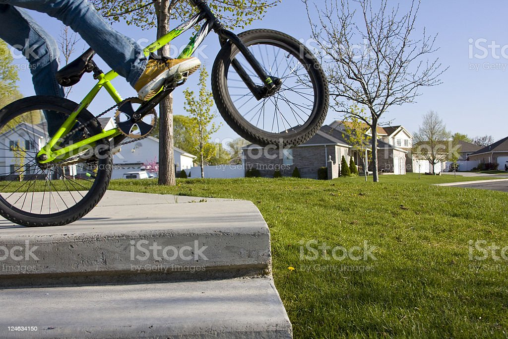 Teenager doing a wheelie royalty-free stock photo