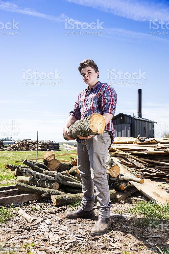 Teenager doing farm chores royalty-free stock photo