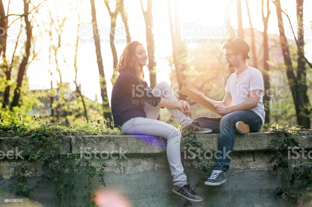 Teenager drawing a girl on his sketch pad royalty-free stock photo