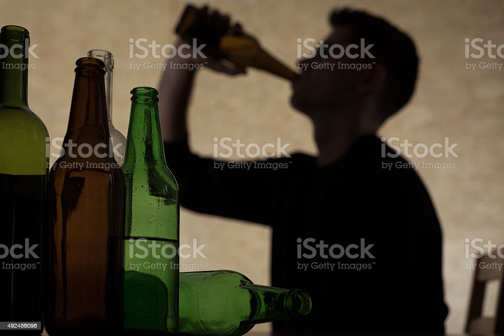 Teenager drinking beer royalty-free stock photo