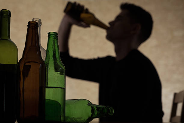 Teenager drinking beer stock photo