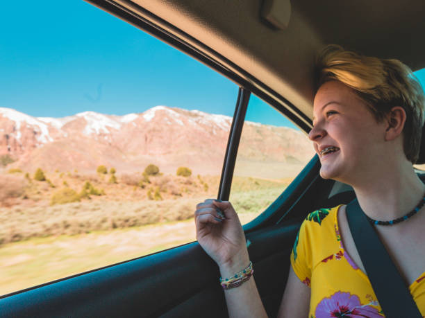 teenager enjoying family road trip - katiedobies stock pictures, royalty-free photos & images