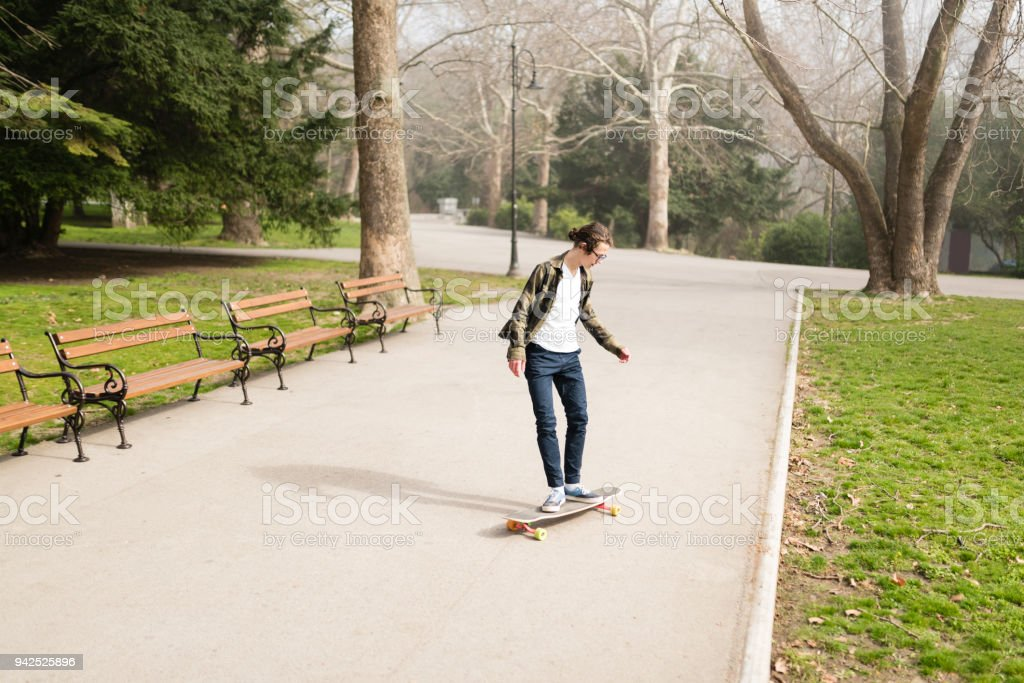 Teenager enjoying his time after school stock photo