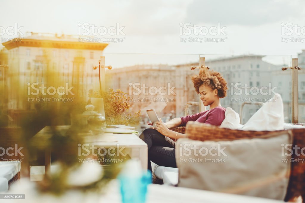 Teenager feemale freelancer with digital pad outdoors in cafe stock photo