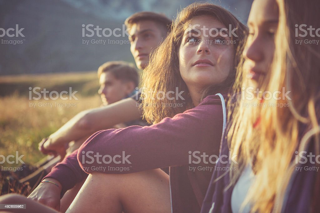 Teenager friends portrait at sunset A group of teenage friends, adventures on the mountain, on the Italian Dolomites. 2015 Stock Photo