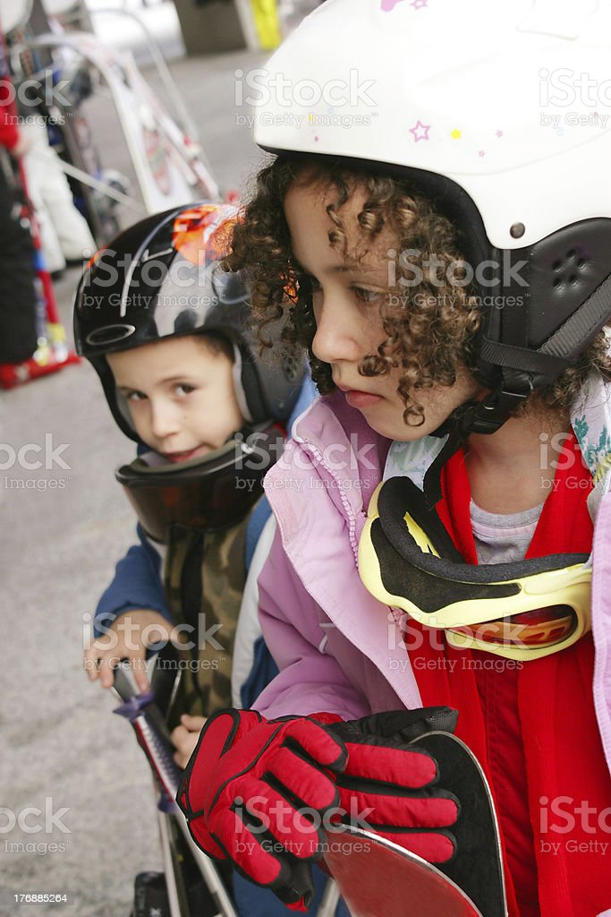 Teenager girl and boy on ski vacation royalty-free stock photo