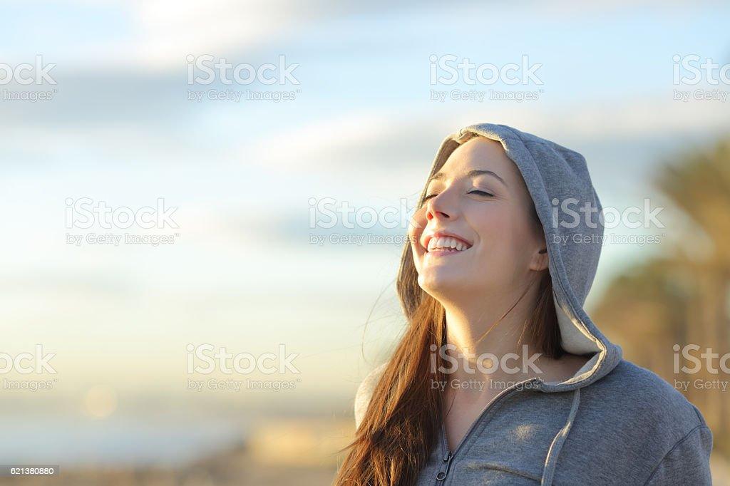 Teenager girl breathing deep fresh air stock photo