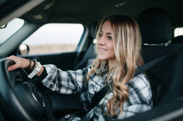 Teenager girl driving a car stock photo