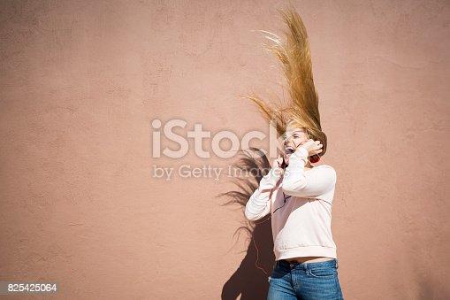 istock Teenager girl enjoying her music 825425064