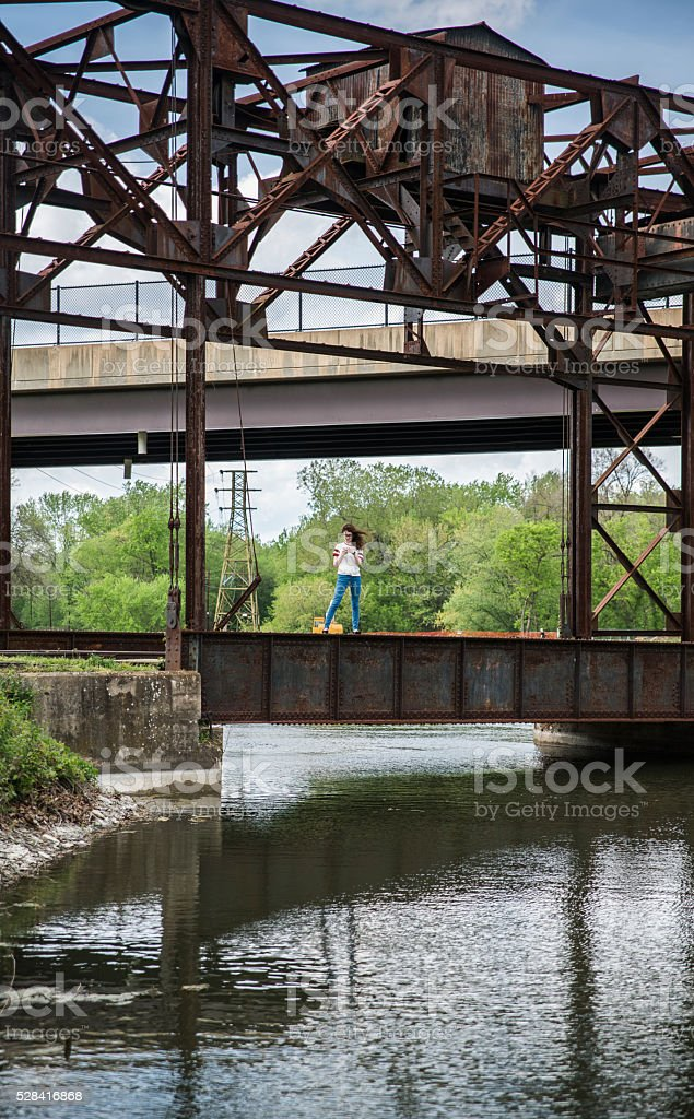 Teenager girl exploring old industrial zone. Williamsport, Maryland, USA stock photo
