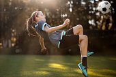 Teenager girl playing soccer