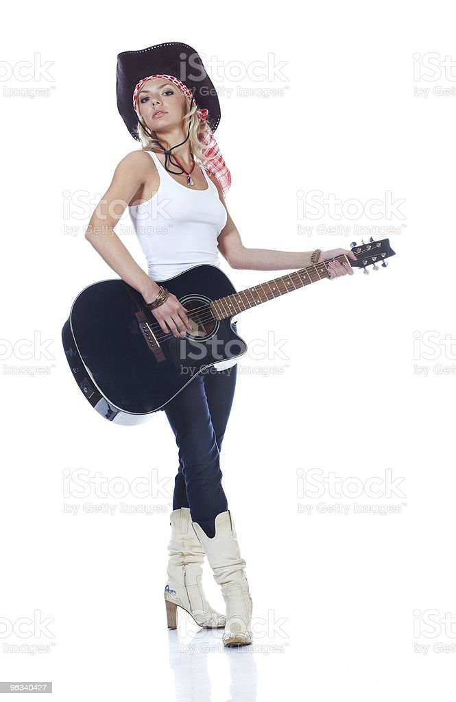 Teenager girl playing with acoustic guitar, isolated on white royalty-free stock photo