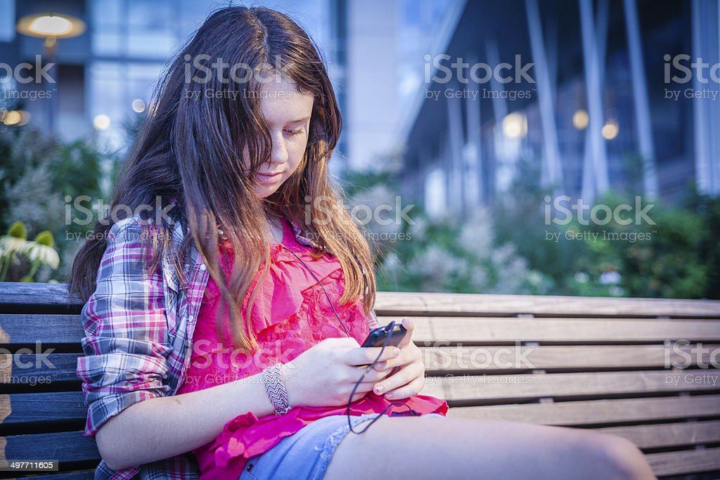 Teenager girl read something at smart phone royalty-free stock photo
