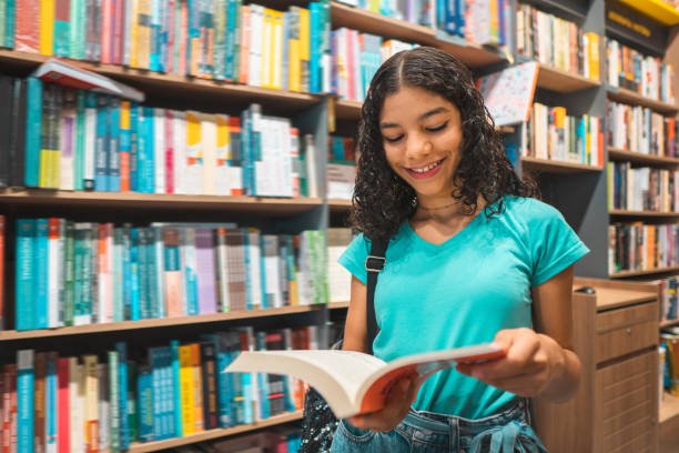Teenager girl reading book in library Reading, Book, Teenage Girls, Library, Brazil cute middle school girls stock pictures, royalty-free photos & images